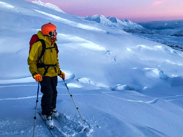 alpine touring to summit during sunset in Thompson Pass
