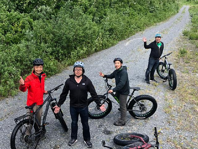 team of startup employees on retreat in Alaska and brainstorming riding bikes