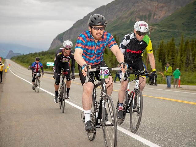 geeks in the woods has software engineer leading the start of Fireweed bike relay race