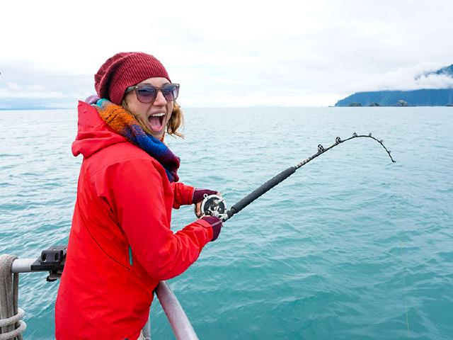 woman in tech on startup retreat fishing for Halibut and Rockfish in Prince William Sound
