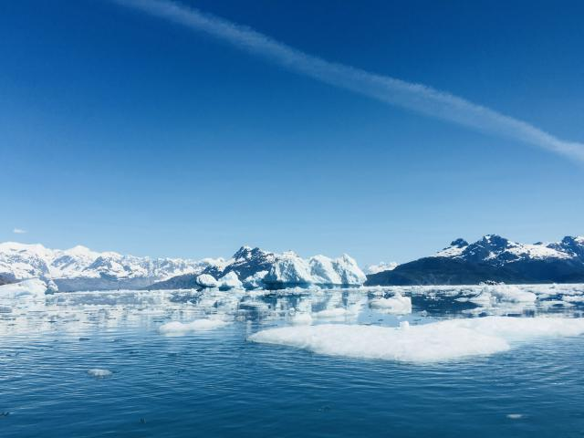 see icebergs break off from glaciers impacted by climate change and accelerated by warm temperatures in summer