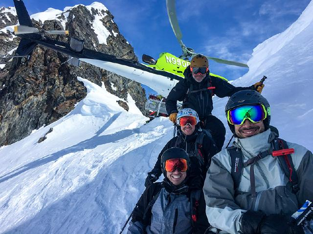 Friends heli-skiing with Alaska Snowboard Guides in Chugach Mountains