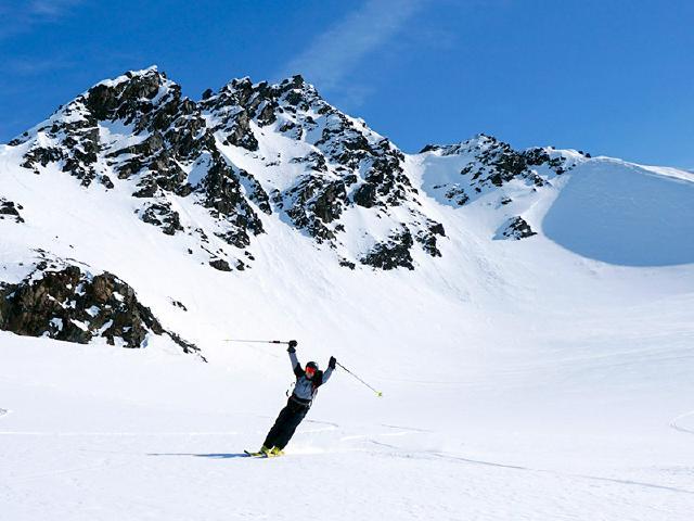 celebrating best heli-ski run of fresh powder in Alaska