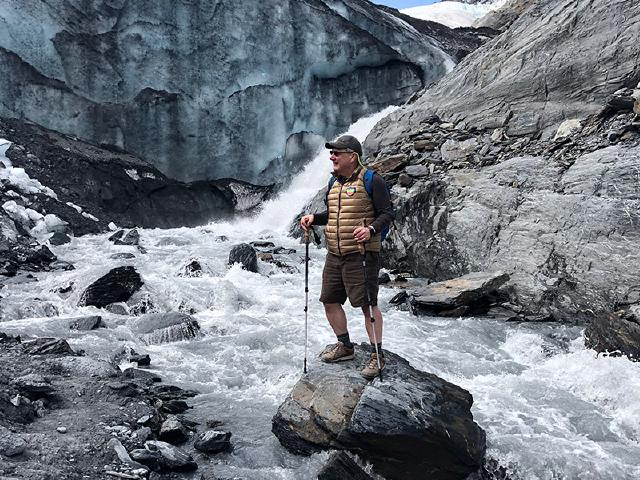 father of startup founder on hike and standing on rock in stream at Worthington Glacier State Park