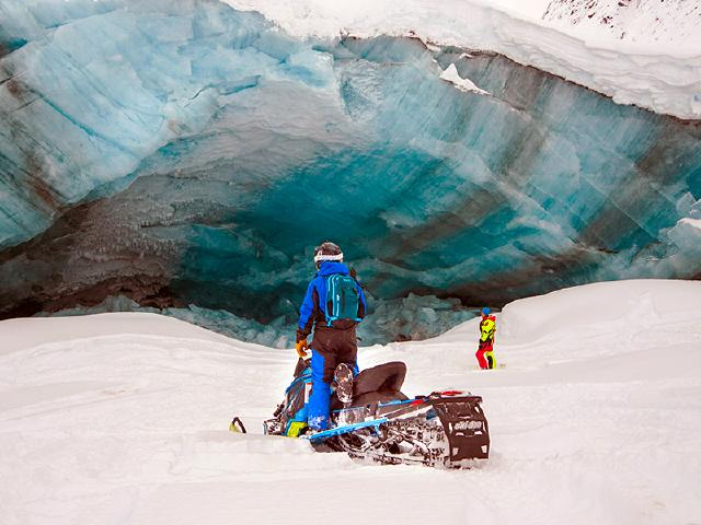 taking friend on snowmobile tour to see ice cave from glacier near Worthington Glacier in Thompson Pass Alaska