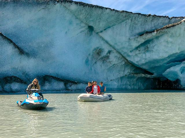 boat of software engineers and tech workers from Seattle in boat on tour of glacier with jet ski guide