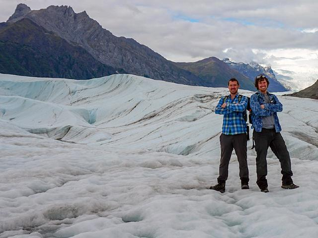twin brothers and startup founders hiking on Root Glacier during summer a few miles from McCarthy Alaska