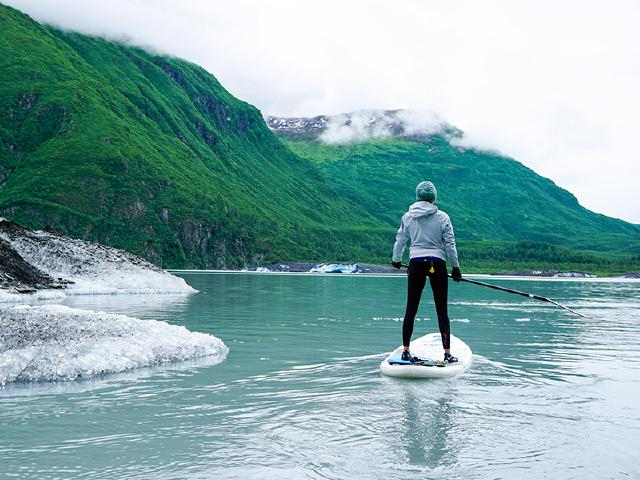 human resources and tech recruiter clearing mind and dreaming of future on standup paddleboard SPU