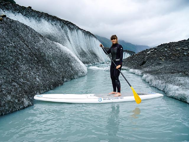 startup employees on paddleboard tour of glacier and icebergs in Alaska disconnected