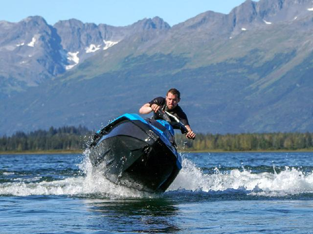 product manager from Seattle driving Seadoo on picture-perfect lake near Valdez