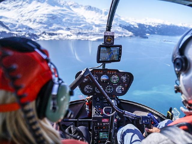 pilot and passenger flying over Prince William Sound and Port Valdez to see best mountains in the world