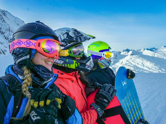 girl friends at top of mountain in Thompson Pass splitboarding