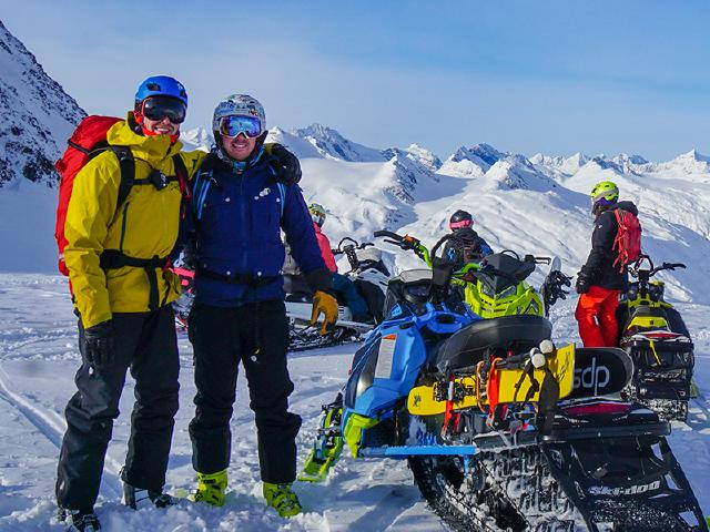 software engineers taking break work life integration for quick laps backcountry skiing using Skidoo snowmobiles