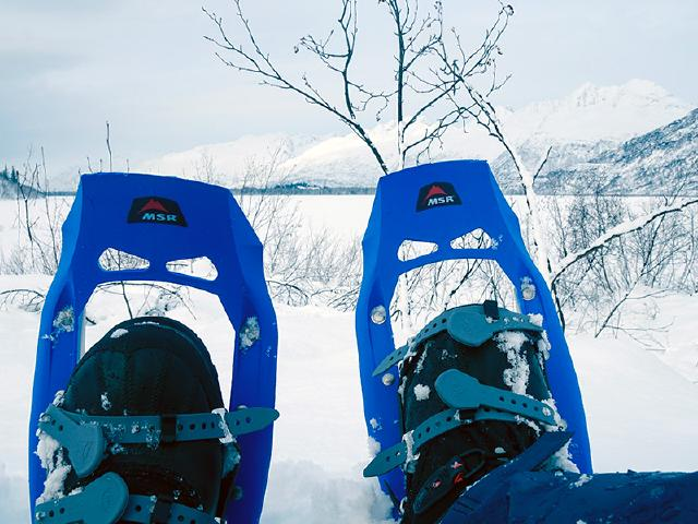 family snowshoeing on Robe Lake with snowshoes