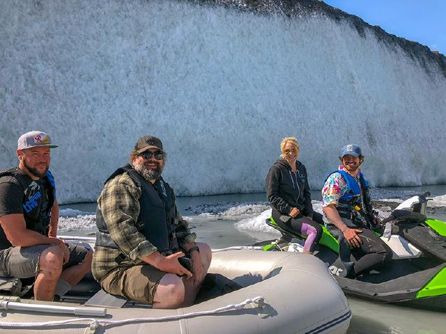 GOlang engineer and web developer from Seattle Washington on guided tour of Valdez Glacier in dingy boat during summer remote retreat