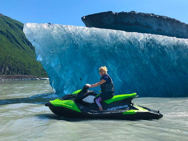 woman in tech riding seadoo on company remote retreat brainstorming in Alaska