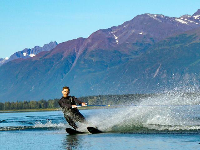 software engineer on lunch break water skiing in mountain Robe lake near Valdez Alaska