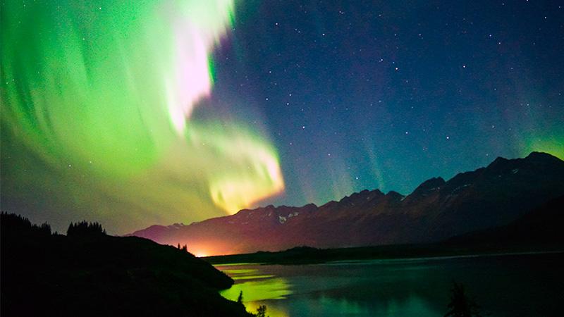 active aurora over Robe Lake in Valdez Alaska