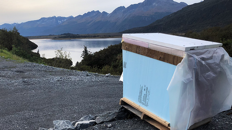 weatherproof camera box taking photographs automatically over lake in Alaska