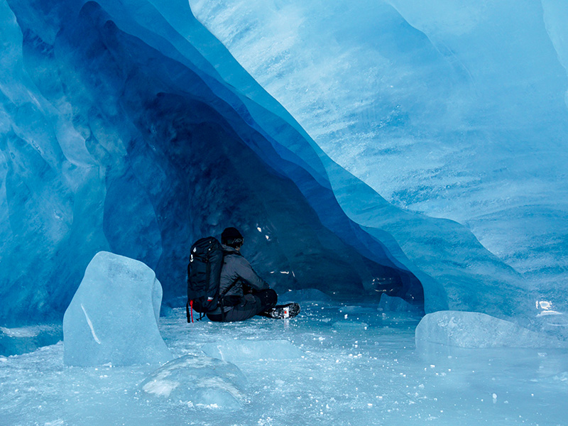 practicing meditation in ice cove at peace with life and mother nature